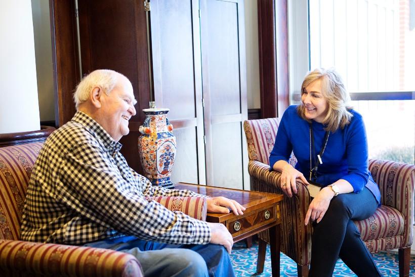 Two seniors talking in their senior living community