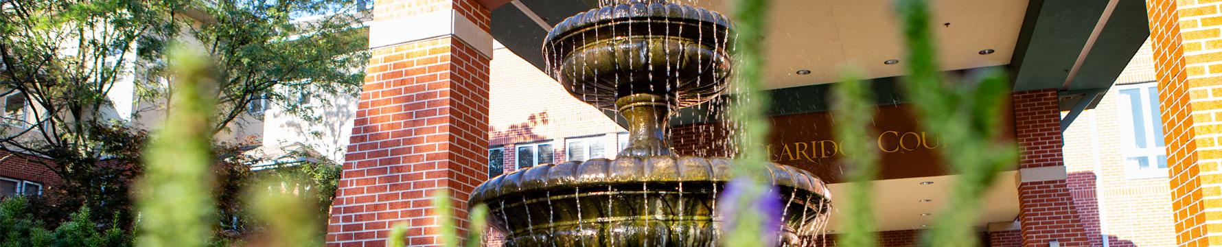 The fountain at the front entrance of Claridge Court senior living community in Prairie Village Kansas